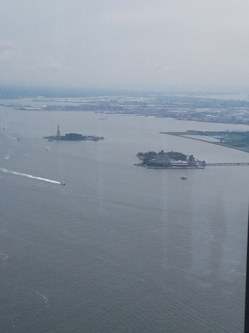 Statue of Liberty on the left, Ellis Island on the right