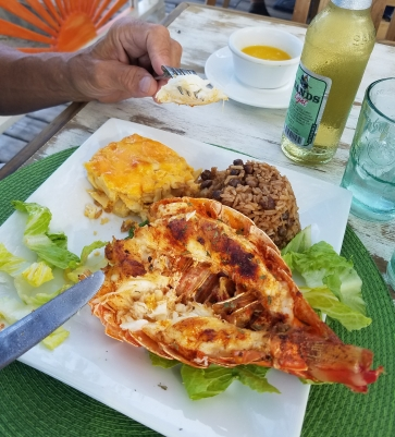 Grilled crawfish (spiny lobster) with Bahamian mac & cheese (cut in squares) and peas with rice.