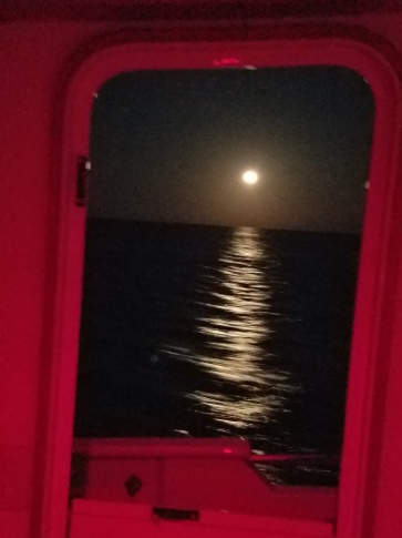 The full moon taken from the pilot house. The red light is for night driving.