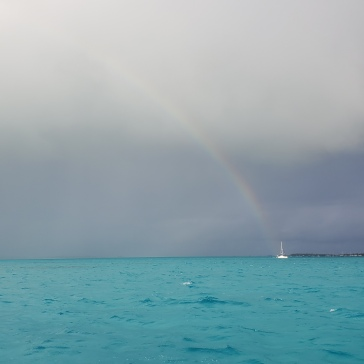 I guess the pot of gold is in that sailboat.